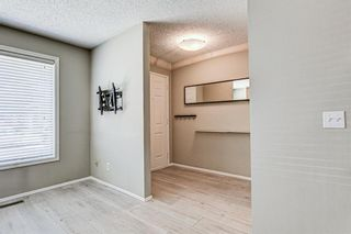 Photo 3: 137 Woodglen Way SW in Calgary: Woodbine Semi Detached for sale : MLS®# A1092343