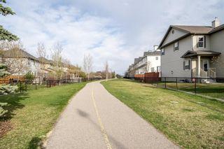 Photo 40: 5 Cougar Ridge Mews SW in Calgary: Cougar Ridge Row/Townhouse for sale : MLS®# A1105171