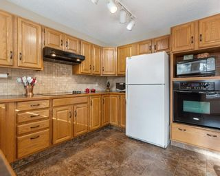 Photo 8: 75 SILVERSTONE Road NW in Calgary: Silver Springs Detached for sale : MLS®# C4287056