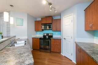 Photo 11: 2427 700 WILLOWBROOK Road NW: Airdrie Apartment for sale : MLS®# A1064770