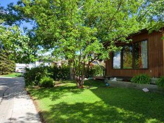 Photo 6: 124 GLENBROOK Road: Cochrane House for sale : MLS®# C4125002