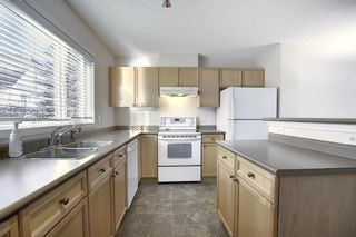Photo 12: 25 Tuscany Springs Gardens NW in Calgary: Tuscany Row/Townhouse for sale : MLS®# A1053153