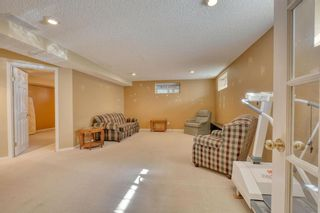 Photo 37: 55 CEDUNA Park SW in Calgary: Cedarbrae Duplex for sale : MLS®# A1015320