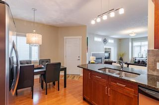 Photo 5: 2 127 27 Avenue NW in Calgary: Tuxedo Park Row/Townhouse for sale : MLS®# A1044558