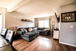 Photo 2: 113 Bedford Manor NE in Calgary: Beddington Heights Row/Townhouse for sale : MLS®# A1095621