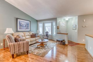 Photo 2: 210 Arbour Cliff Close NW in Calgary: Arbour Lake Semi Detached for sale : MLS®# A1086025