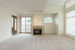 "Photo 3: 404 19131 FORD Road in Pitt Meadows: Central Meadows Condo for sale in ""WOODFORD MANOR"" : MLS®# R2372445"