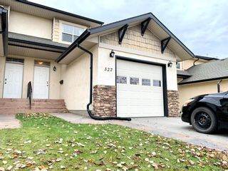 Main Photo: 327 Addington Drive: Red Deer Row/Townhouse for sale : MLS®# A1084149