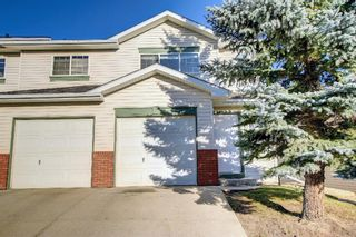 Photo 1: 29 Country Hills Rise NW in Calgary: Country Hills Row/Townhouse for sale : MLS®# A1149774