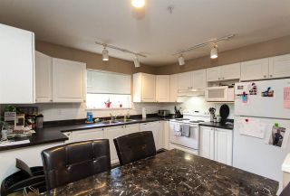 """Photo 7: 210 19953 55A Avenue in Langley: Langley City Condo for sale in """"Bayside Court"""" : MLS®# R2245615"""