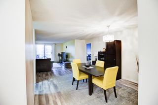 Photo 4: 209 2022 CANYON MEADOWS Drive SE in Calgary: Queensland Apartment for sale : MLS®# A1028544