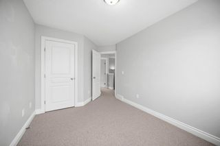 Photo 22: 5 Cougar Ridge Mews SW in Calgary: Cougar Ridge Row/Townhouse for sale : MLS®# A1105171