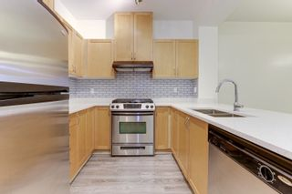 """Photo 14: 108 2951 SILVER SPRINGS Boulevard in Coquitlam: Westwood Plateau Condo for sale in """"TANTULUS"""" : MLS®# R2601029"""