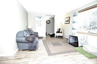 Photo 7: 707 Canfield Place SW in Calgary: Canyon Meadows Detached for sale : MLS®# A1063933