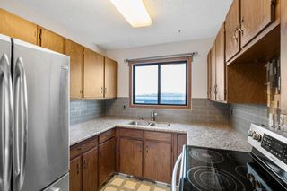 Photo 10: 72 Shawmeadows Crescent SW in Calgary: Shawnessy Detached for sale : MLS®# A1097940