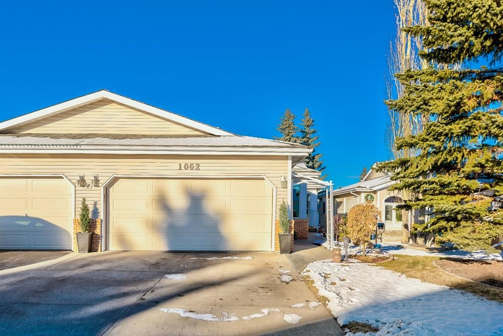 Main Photo: 1062 Shawnee Road SW in Calgary: Shawnee Slopes Semi Detached for sale : MLS®# A1055358