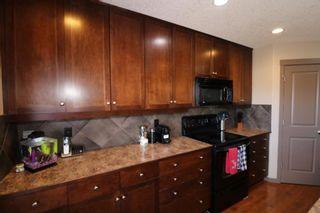 Photo 11: 151 Silverado Drive SW in Calgary: Silverado Detached for sale : MLS®# A1124527