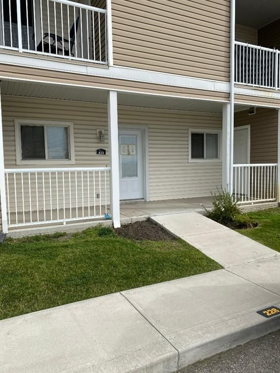 Main Photo: 415 Sunrise Terrace NE: High River Row/Townhouse for sale : MLS®# A1037951