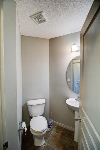 Photo 7: 50 Auburn Bay Common SE in Calgary: Auburn Bay Row/Townhouse for sale : MLS®# A1128928