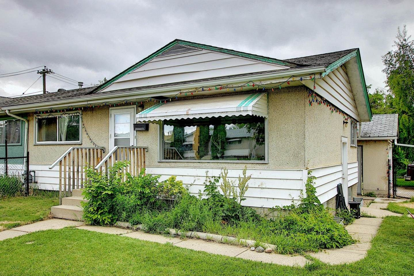 Main Photo: 12009 36 Street in Edmonton: Zone 23 House Half Duplex for sale : MLS®# E4261986