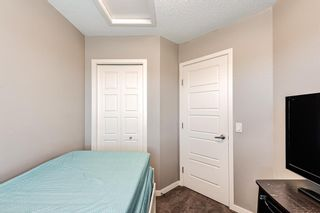 Photo 22: 504 Panatella Walk NW in Calgary: Panorama Hills Row/Townhouse for sale : MLS®# A1153133