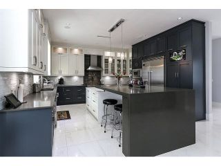 Photo 4: 4038 RUMBLE ST - LISTED BY SUTTON CENTRE REALTY in Burnaby: Suncrest House for sale (Burnaby South)  : MLS®# V1122974