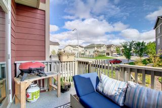 Photo 8: 1103 125 Panatella Way NW in Calgary: Panorama Hills Row/Townhouse for sale : MLS®# A1143179