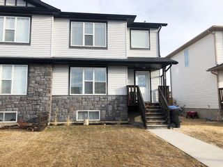Photo 1: 1558 McAlpine Street: Carstairs Semi Detached for sale : MLS®# A1081216