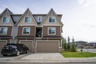 Photo 1: 1601 250 fireside Drive: Cochrane Row/Townhouse for sale : MLS®# A1143826