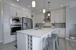 Photo 6: 28 Sundown Avenue: Cochrane Detached for sale : MLS®# A1071788