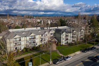 """Photo 1: 311 20881 56 Avenue in Langley: Langley City Condo for sale in """"Roberts Court"""" : MLS®# R2437308"""