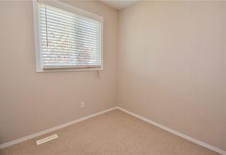 Photo 15: 816 MADEIRA Drive NE in Calgary: Marlborough Park Row/Townhouse for sale : MLS®# C4262604