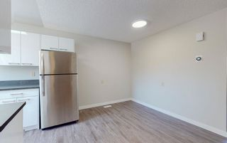 Photo 11: 127 16725 106 Street NW in Edmonton: Zone 27 Townhouse for sale : MLS®# E4244784