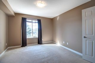 Photo 7: 1208 92 Crystal Shores Road: Okotoks Apartment for sale : MLS®# A1089465