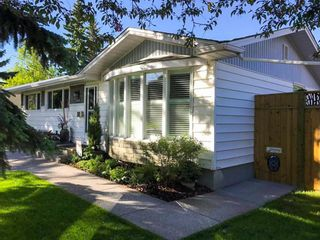Photo 2: 2412 Langriville Drive SW in Calgary: North Glenmore Park Detached for sale : MLS®# A1113209