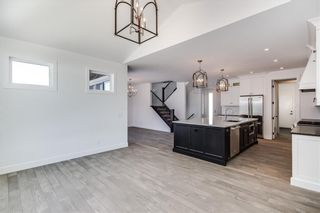 Photo 17: 152 ROCK LAKE View NW in Calgary: Rocky Ridge Detached for sale : MLS®# A1062711