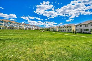 Photo 20: 298 SUNSET Point: Cochrane Row/Townhouse for sale : MLS®# A1033505