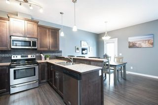 Photo 5: 407 Ranch Ridge Meadow: Strathmore Row/Townhouse for sale : MLS®# A1074181
