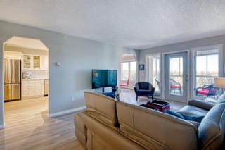 Photo 4: 404 7239 Sierra Morena Boulevard SW in Calgary: Signal Hill Apartment for sale : MLS®# A1153307