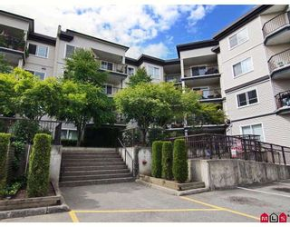"""Photo 1: 406 5765 GLOVER Road in Langley: Langley City Condo for sale in """"College Court"""" : MLS®# F2818017"""