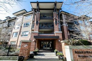 "Photo 1: 322 700 KLAHANIE Drive in Port Moody: Port Moody Centre Condo for sale in ""BOARDWALK"" : MLS®# R2039030"