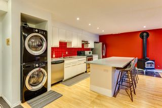 Photo 3: 101 1059 5 Avenue NW in Calgary: Sunnyside Apartment for sale : MLS®# A1115946