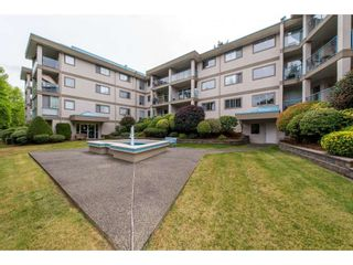 "Photo 1: 103 33090 GEORGE FERGUSON Way in Abbotsford: Central Abbotsford Condo for sale in ""Tiffany Place"" : MLS®# R2394882"