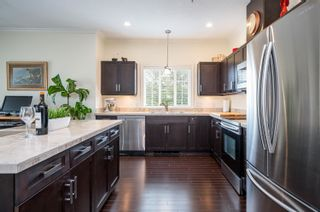 """Photo 12: 411 20281 53A Avenue in Langley: Langley City Condo for sale in """"Gibbons Layne"""" : MLS®# R2621680"""