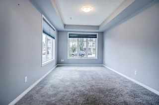 Photo 24: 129 Windstone Park SW: Airdrie Row/Townhouse for sale : MLS®# A1137155