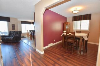 Photo 4: 784 LUXSTONE Landing SW: Airdrie House for sale : MLS®# C4160594
