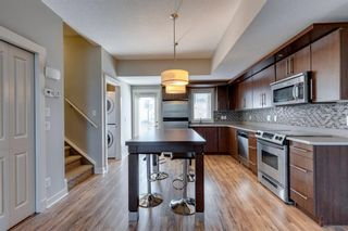 Photo 3: 740 73 Street SW in Calgary: West Springs Row/Townhouse for sale : MLS®# A1138504