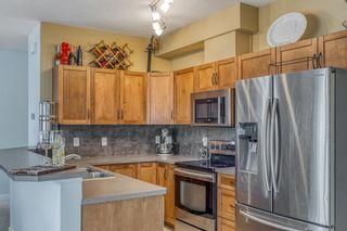 Photo 6: 1401 281 COUGAR RIDGE Drive SW in Calgary: Cougar Ridge Row/Townhouse for sale : MLS®# A1070231