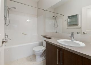 Photo 18: 106 WEST SPRINGS Road SW in Calgary: West Springs Row/Townhouse for sale : MLS®# A1128292