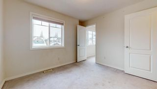 Photo 22: 48 Moreuil Court SW in Calgary: Garrison Woods Detached for sale : MLS®# A1075333